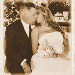 B&G kissing on church pew